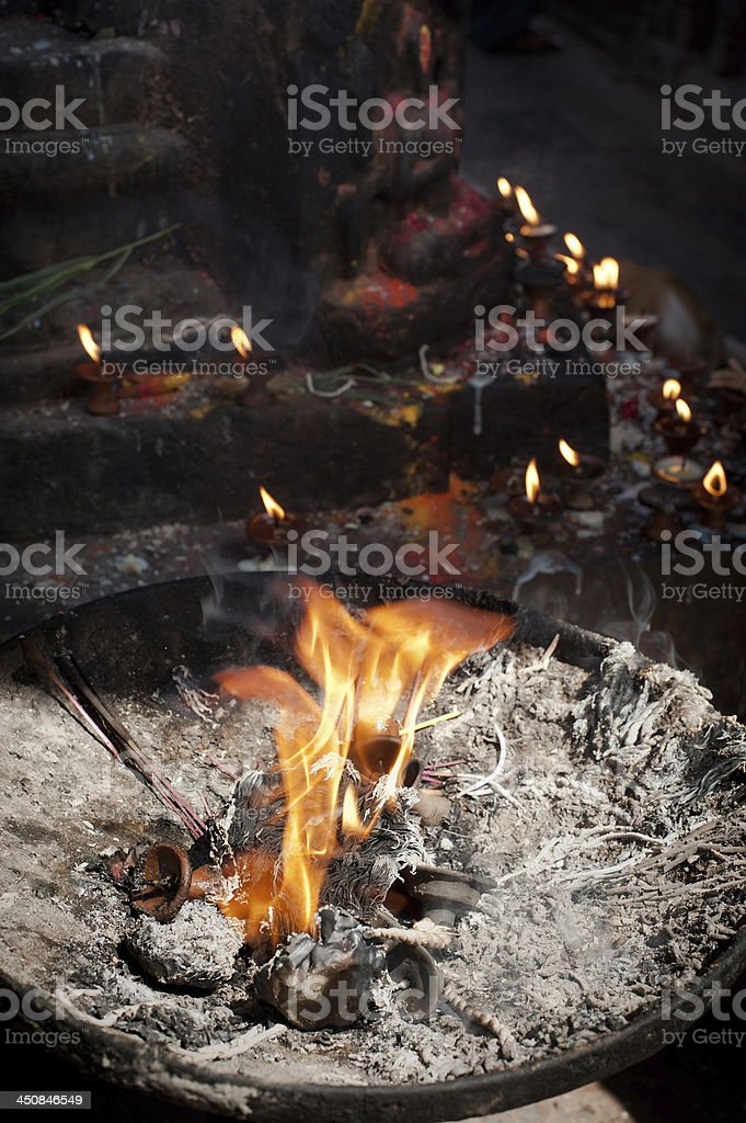 Birning candles and offerings at Temple royalty-free stock photo