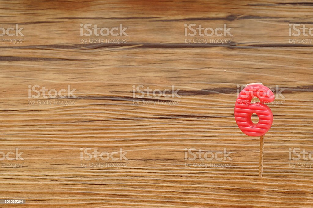 Birth day candle isolated on a wooden background. stock photo