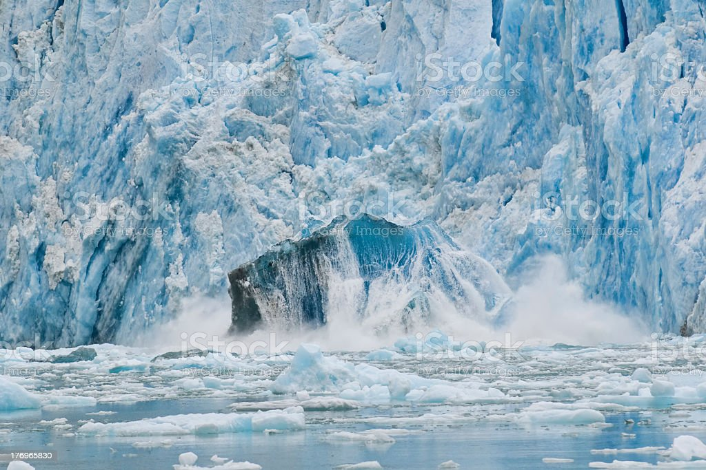 Birth of an iceberg shooter at Dawes Glacier Alaska stock photo