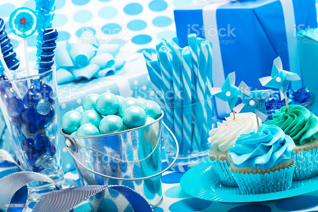 Birthday Boy Blue Party with Candy Presents and Cupcakes stock photo