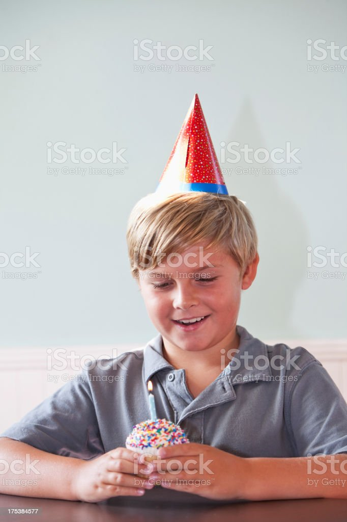 Birthday boy with cupcake stock photo