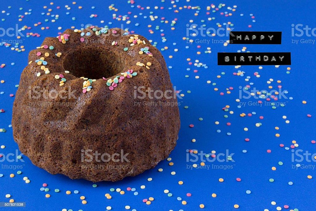 Birthday Bundt Cake and Sprinkles stock photo