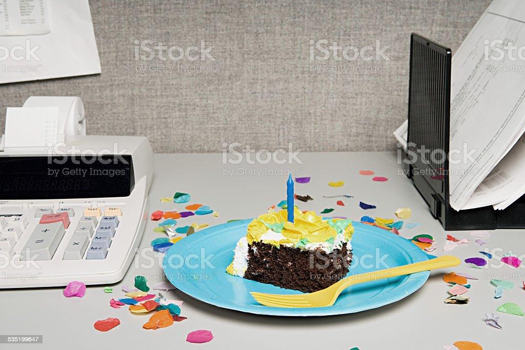 Birthday cake on an office desk stock photo