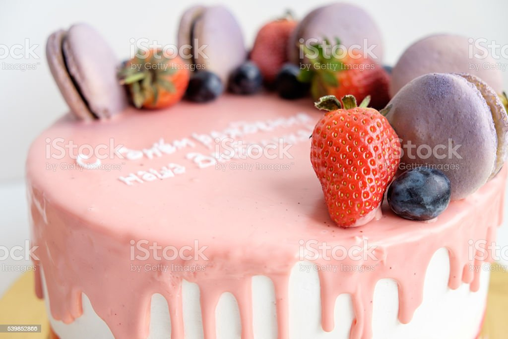 birthday cake with berry and macaroons stock photo