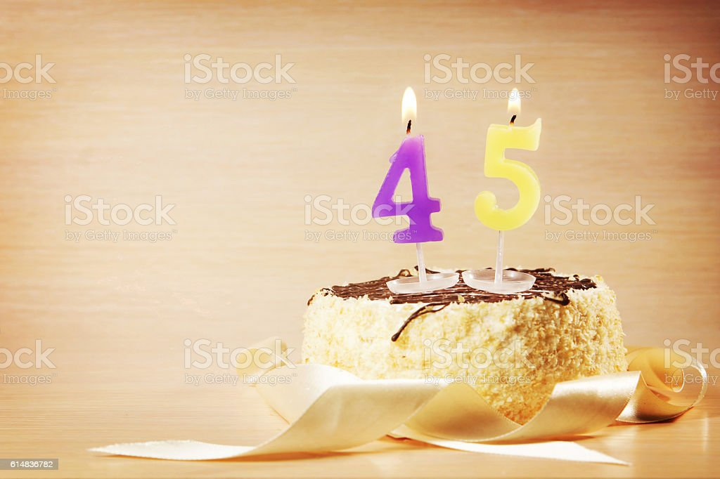 Birthday cake with burning candle as a number forty five stock photo