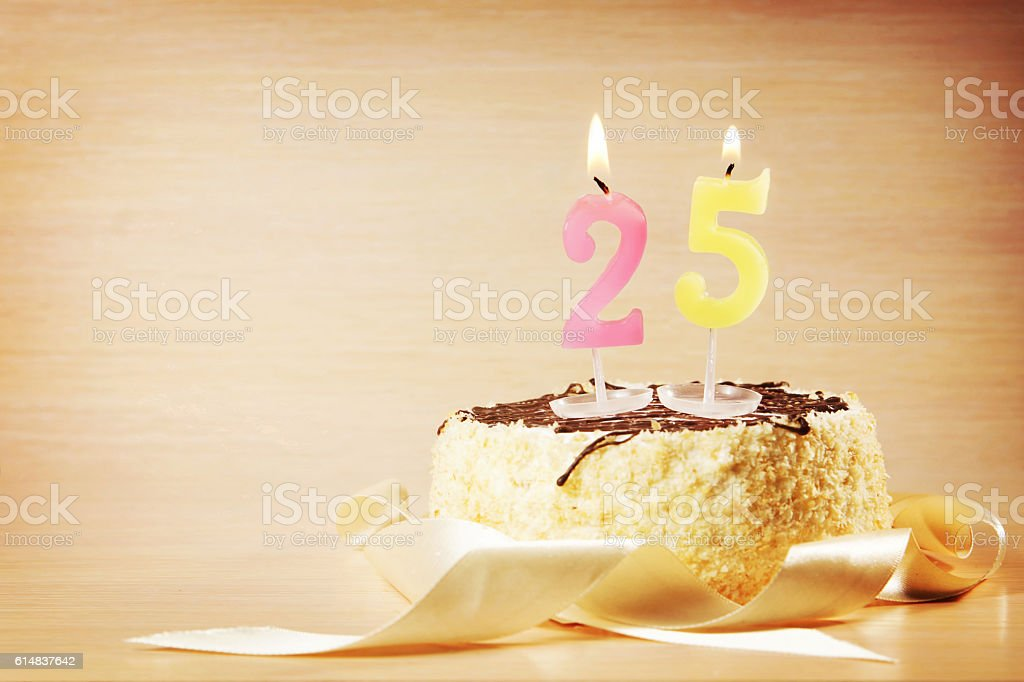 Birthday cake with burning candle as a number twenty five stock photo
