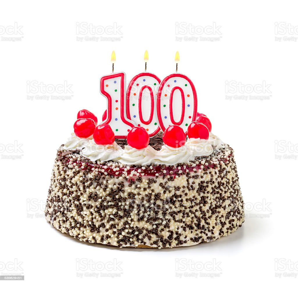 Birthday cake with burning candle number 100 stock photo
