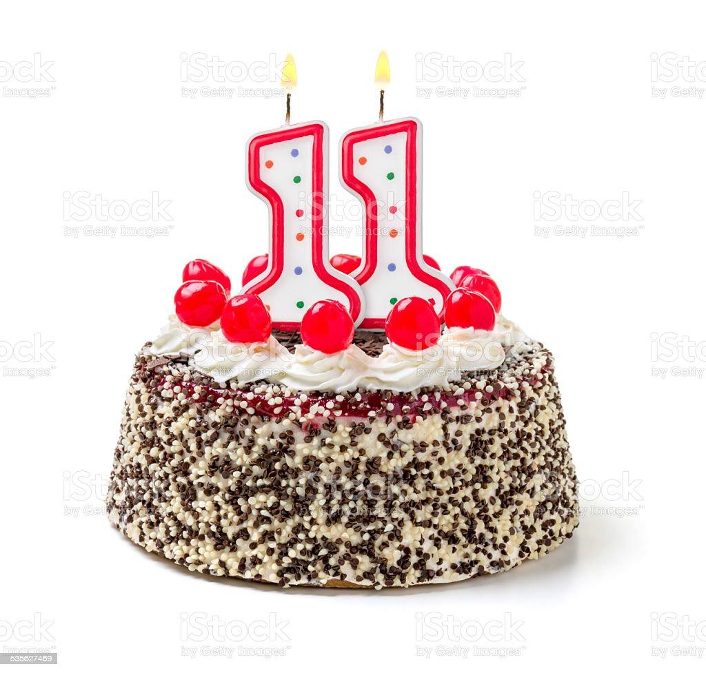Birthday cake with burning candle number 11 stock photo