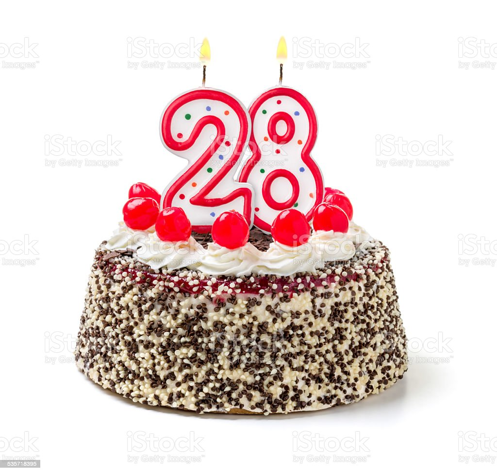 Birthday cake with burning candle number 28 stock photo