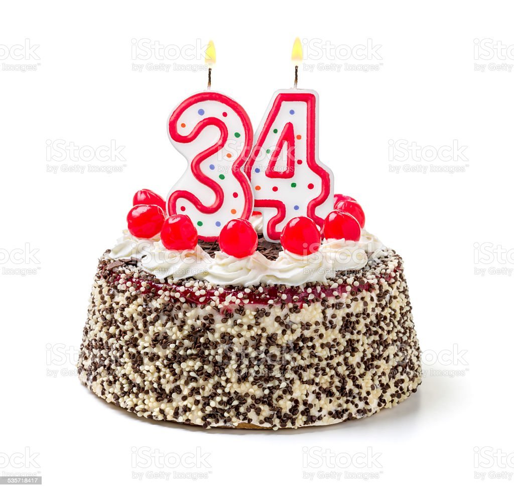 Birthday cake with burning candle number 34 stock photo