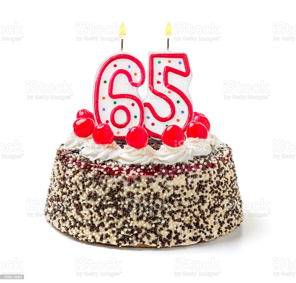 Birthday cake with burning candle number 65 stock photo