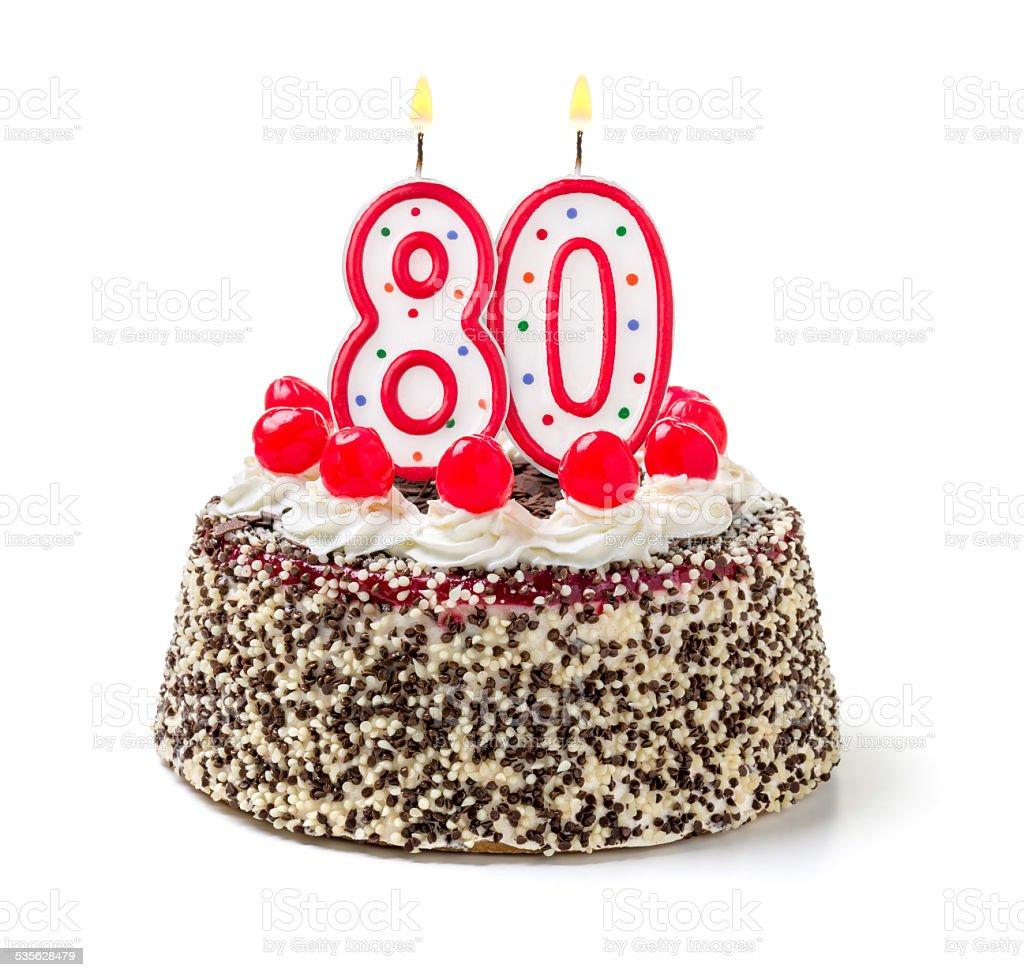 Birthday cake with burning candle number 80 stock photo