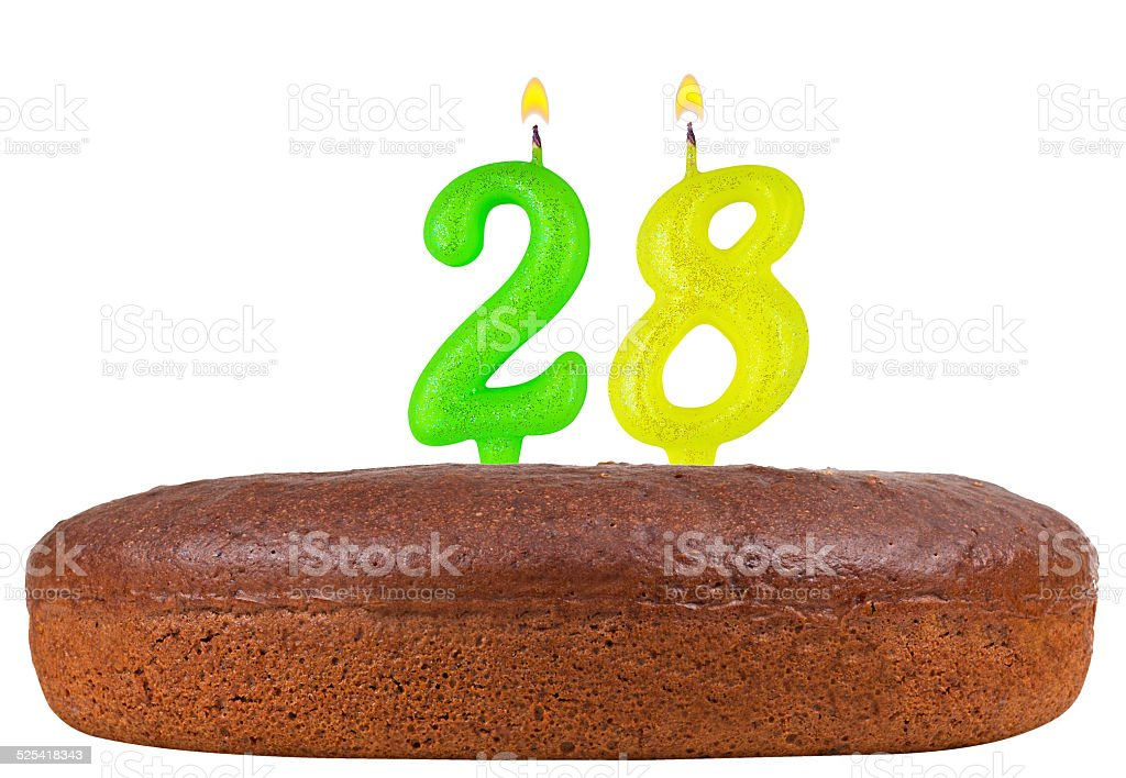 birthday cake with candles number 28 isolated stock photo