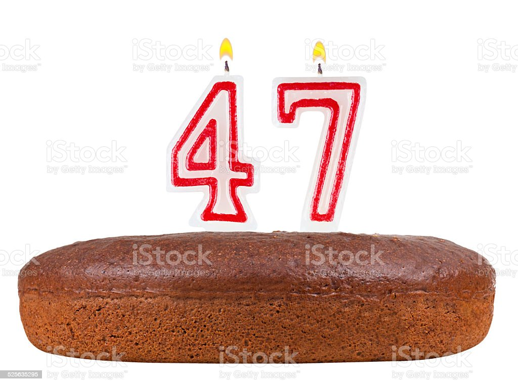 birthday cake with candles number 47 isolated stock photo