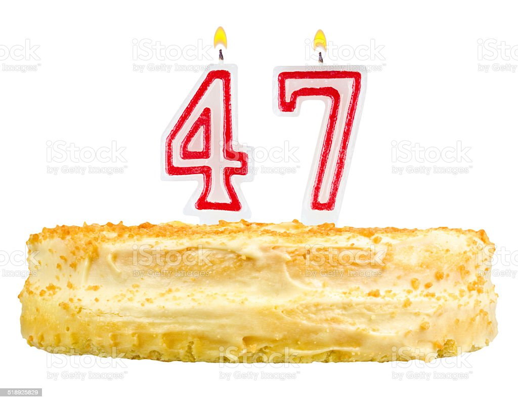 birthday cake with candles number forty seven isolated on white stock photo