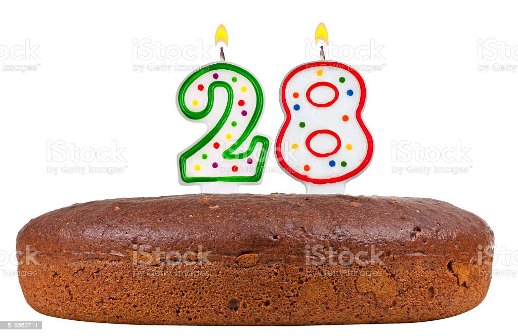 birthday cake with candles number twenty eight isolated on white stock photo
