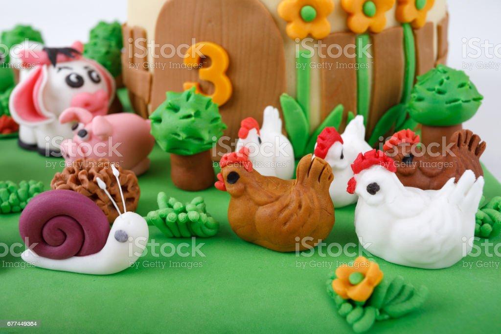 birthday cake with farm marzipan animals stock photo