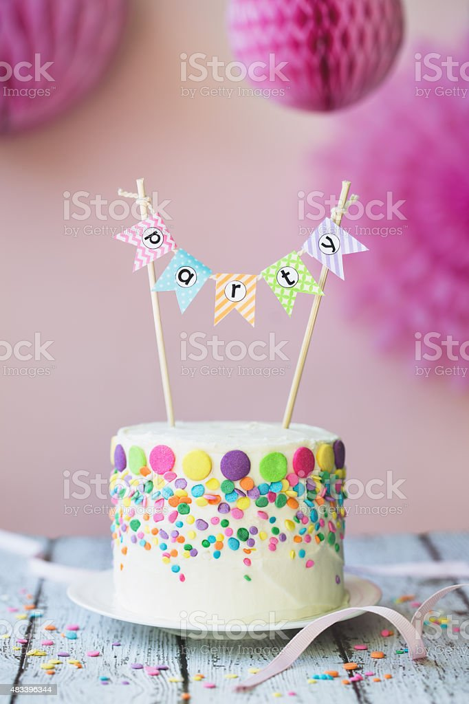 Birthday cake with party banner stock photo