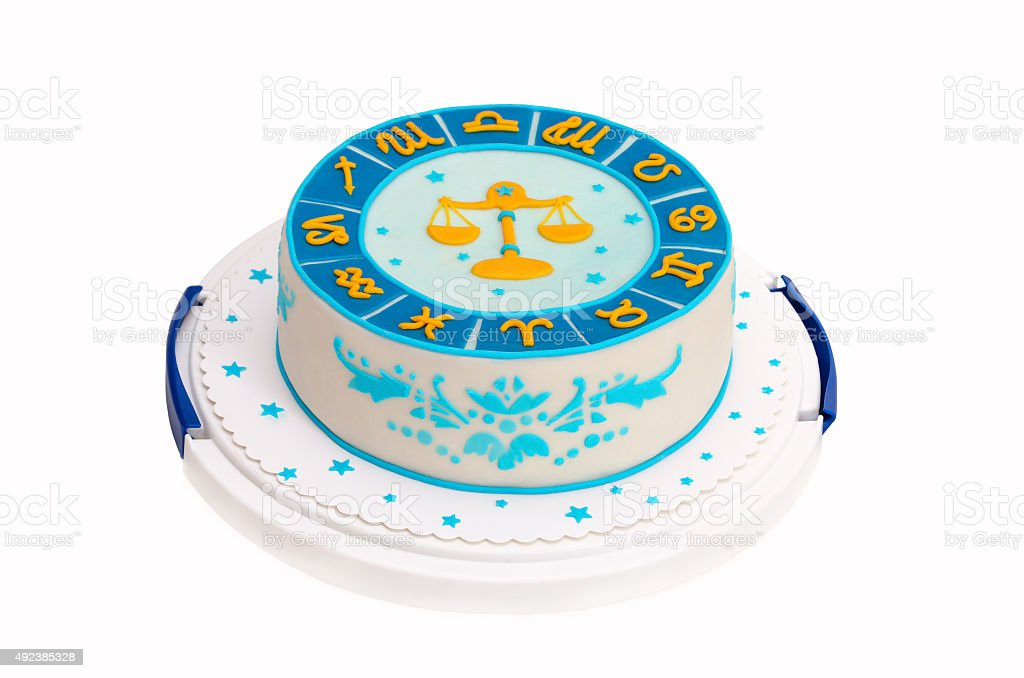 birthday cake with zodiac symbols and libra isolated on white stock photo