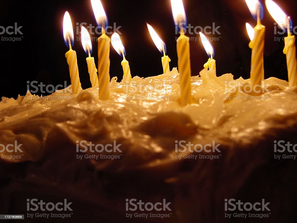 Birthday candles and cake frosting royalty-free stock photo