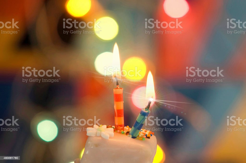 Birthday candles in a cake stock photo