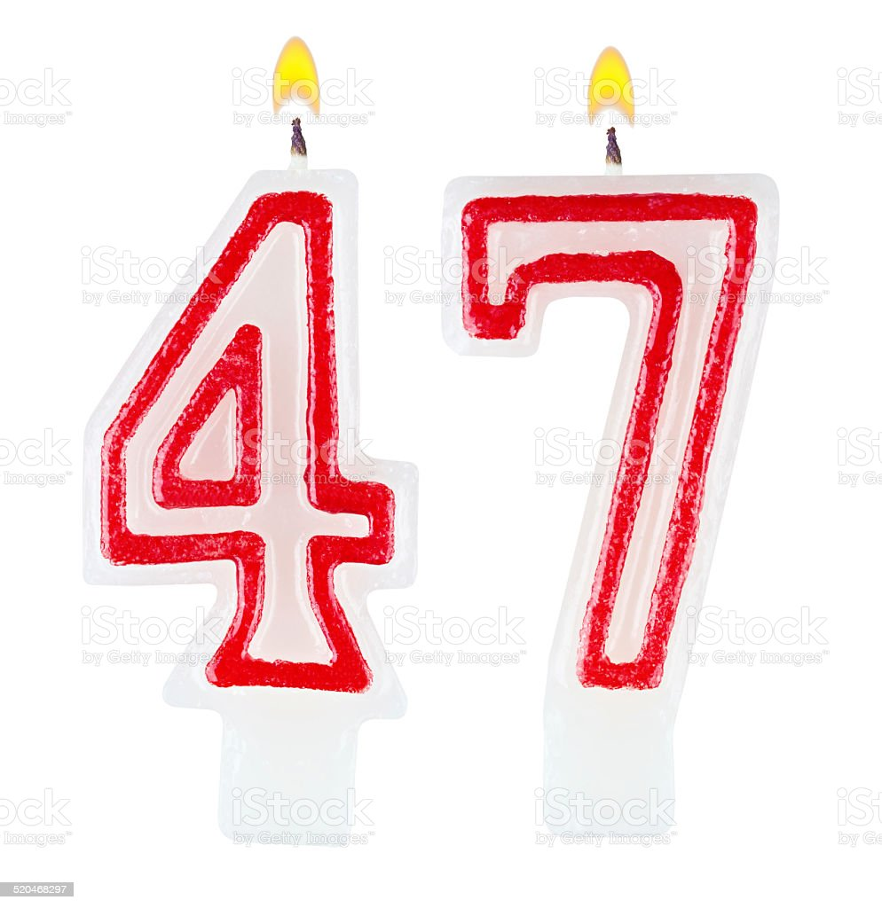 Birthday candles number forty seven isolated on white background stock photo