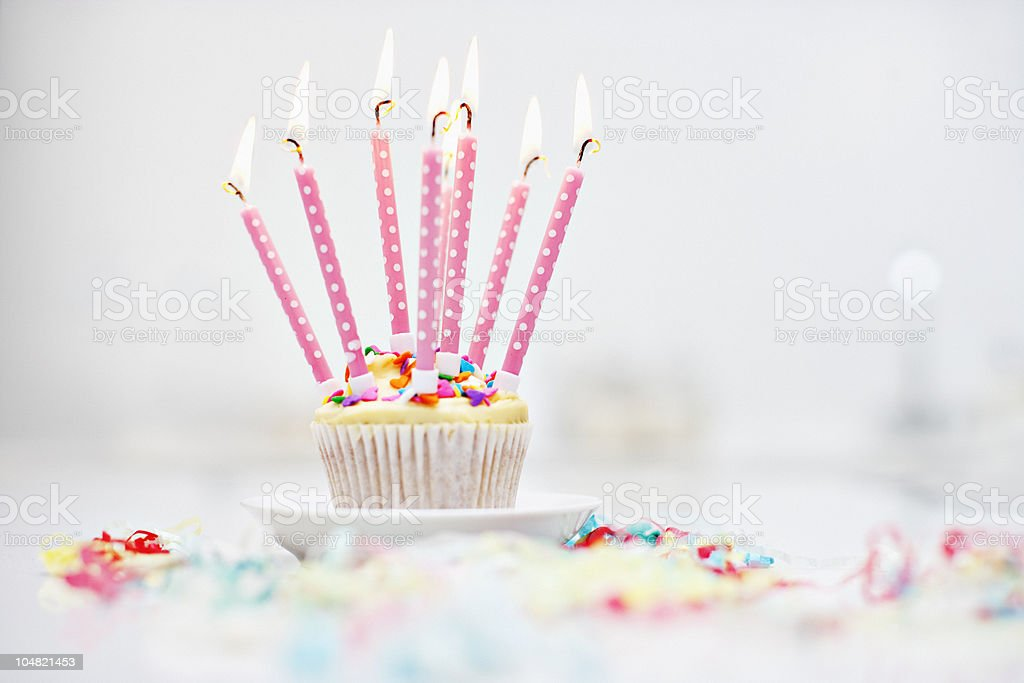 Birthday candles on cupcake stock photo