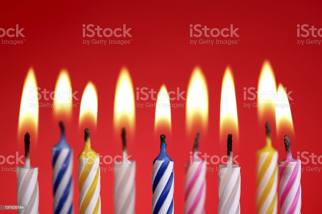 Birthday candles on red royalty-free stock photo