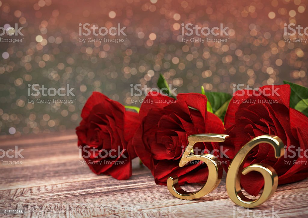 birthday concept with red roses on wooden desk. fifty-sixth stock photo