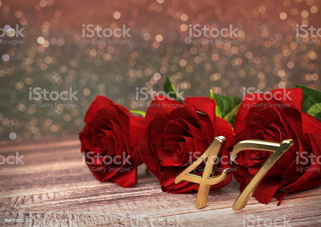birthday concept with red roses on wooden desk. forty-seventh stock photo
