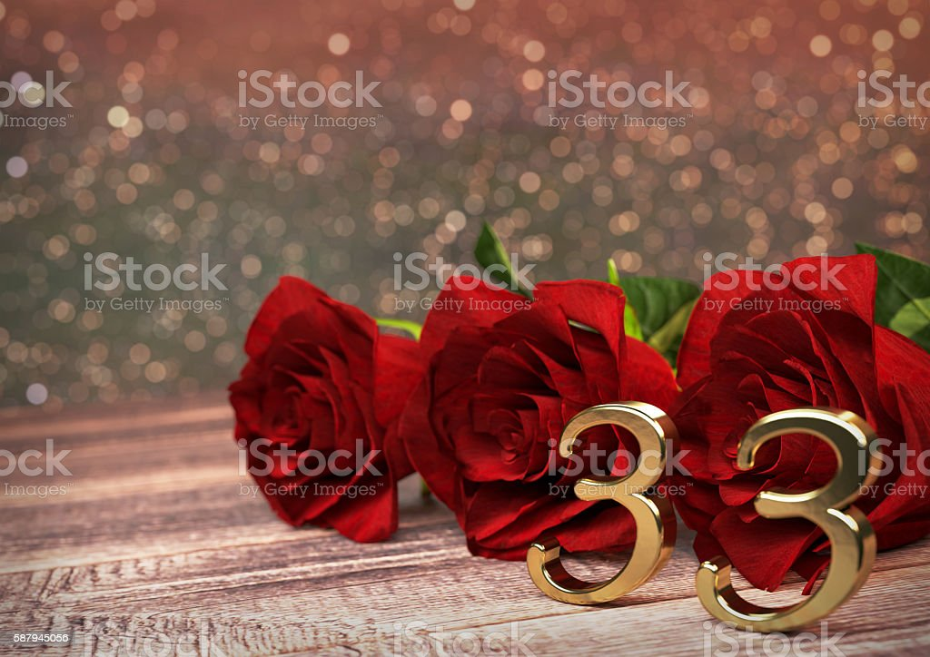 birthday concept with red roses on wooden desk. thirty-third stock photo
