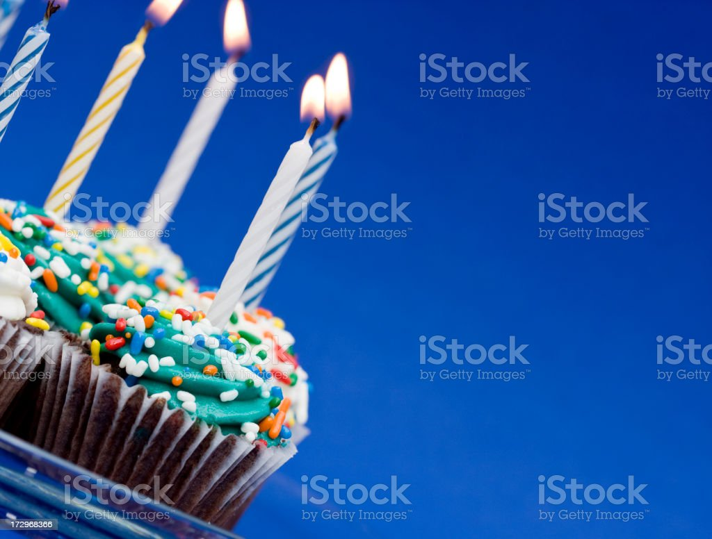 Birthday cupcakes and candles royalty-free stock photo