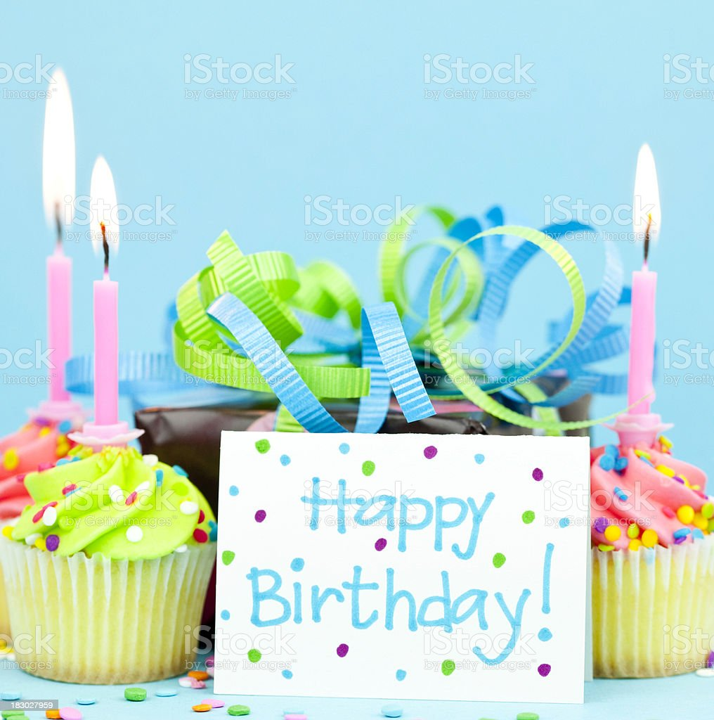 Birthday Gift and Cupcakes stock photo