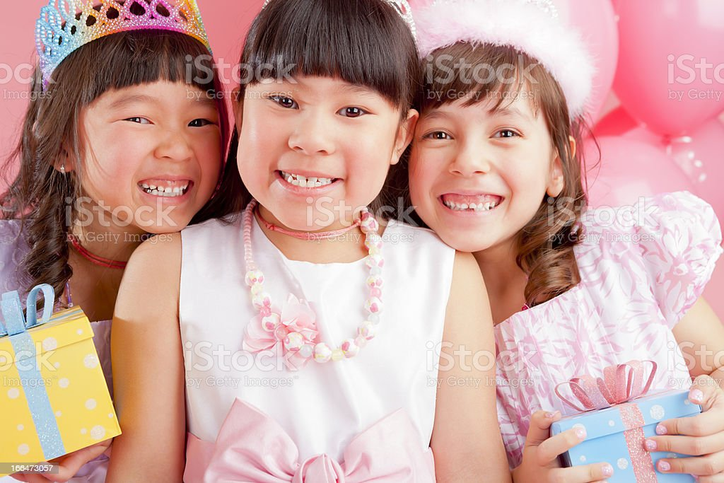 Birthday girl celebrating with friends royalty-free stock photo