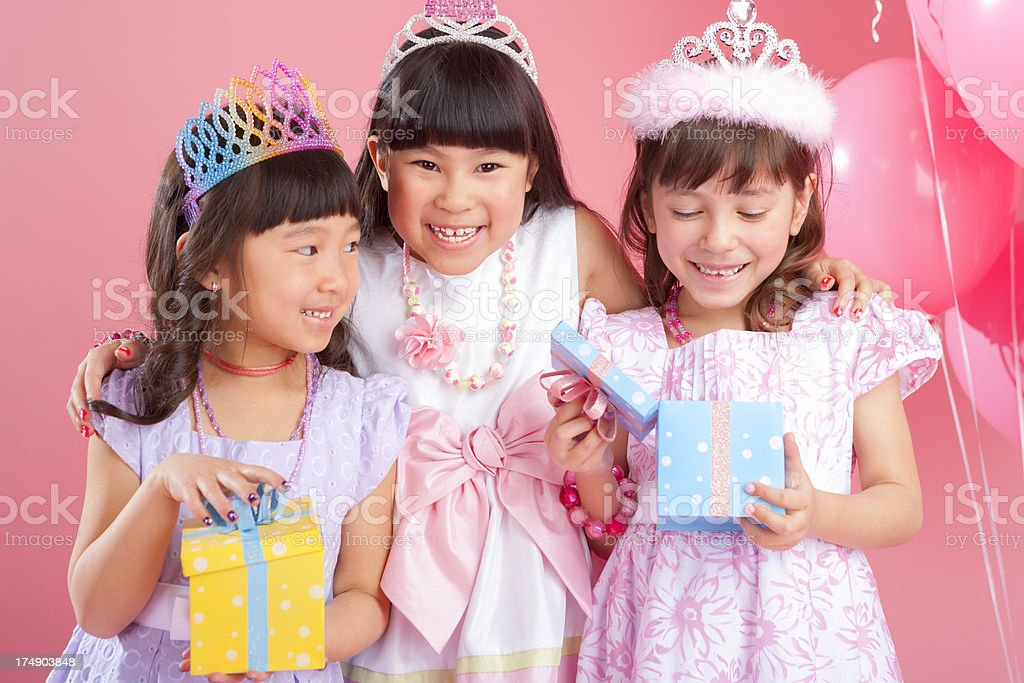 Birthday girl celebrating with friends stock photo