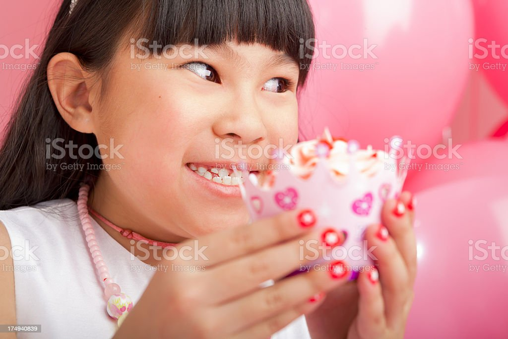 Birthday girl holding a gift royalty-free stock photo