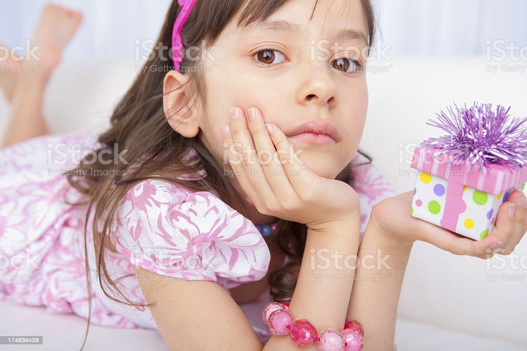 Birthday girl holding a present royalty-free stock photo
