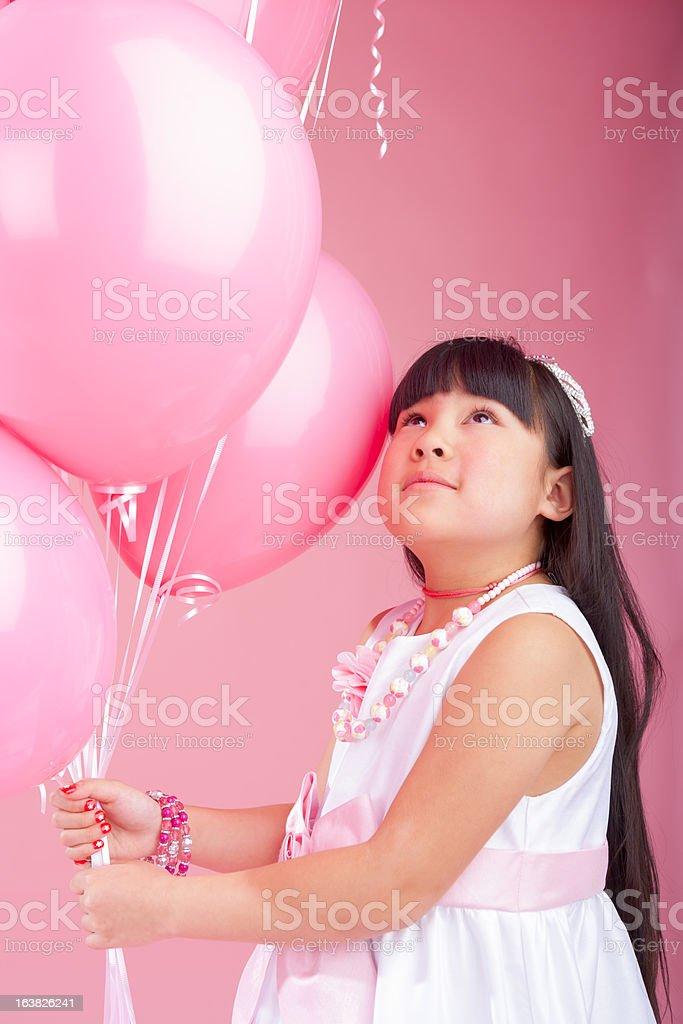 Birthday girl holding balloons royalty-free stock photo