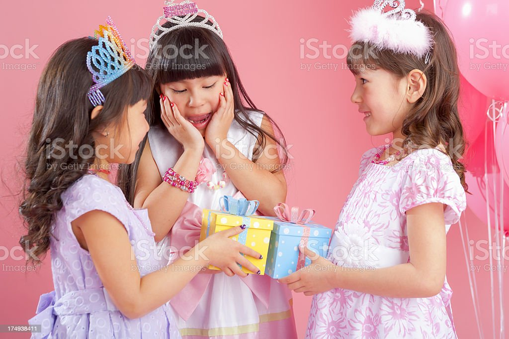 Birthday girl surprised by presents from friends stock photo