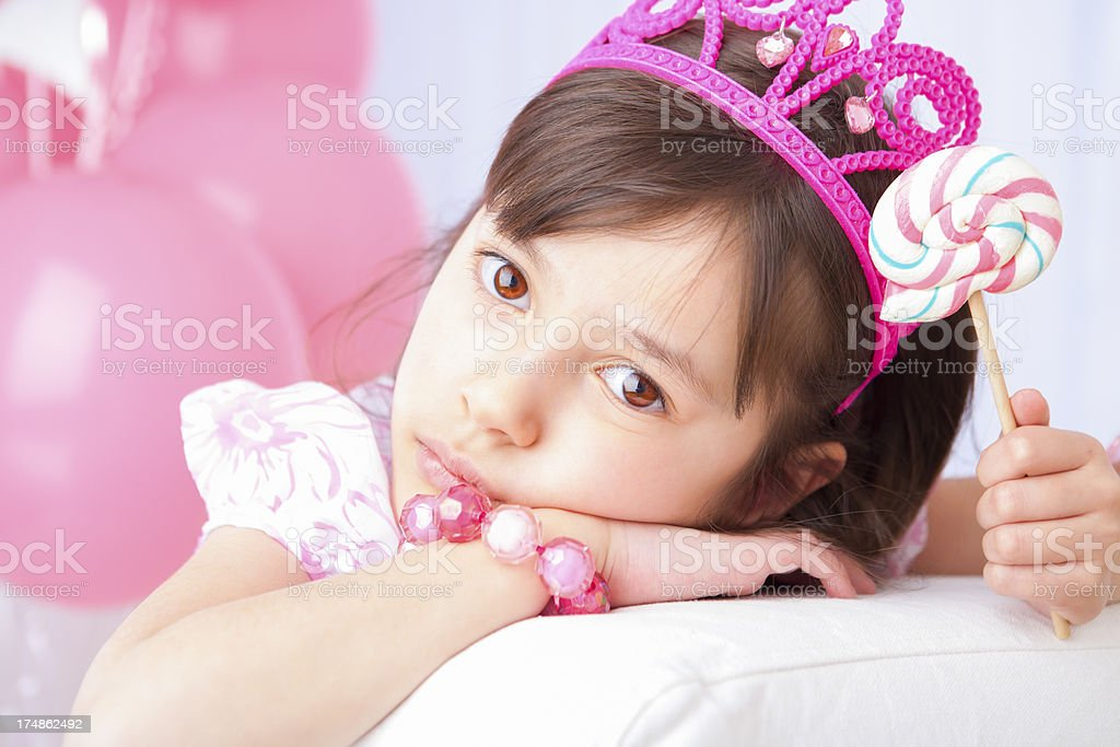 Birthday girl tired from her party royalty-free stock photo