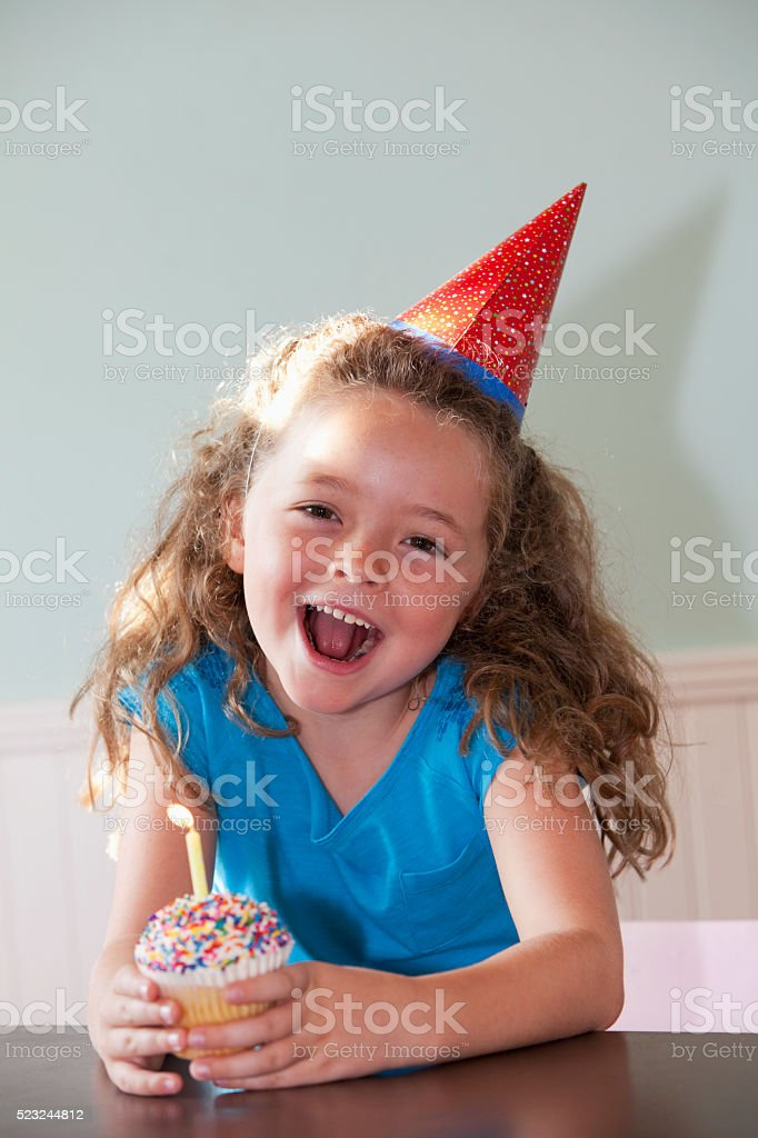 Birthday girl with cupcake stock photo