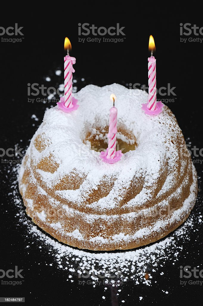 Birthday Gugelhupf Cake with Little Pink Burning Candles Black Background stock photo