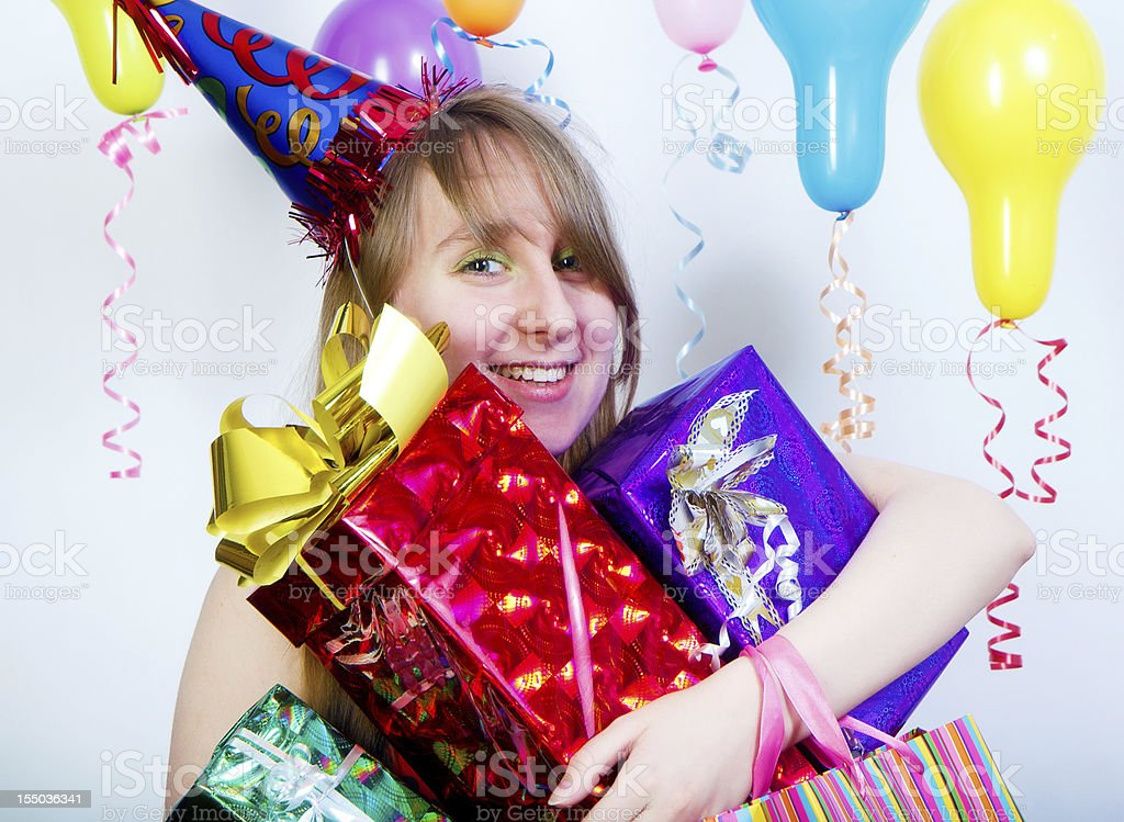 Birthday. happy young girl with gifts royalty-free stock photo