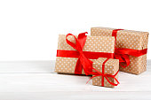 Birthday holiday gift box in wrapping paper isolated on white