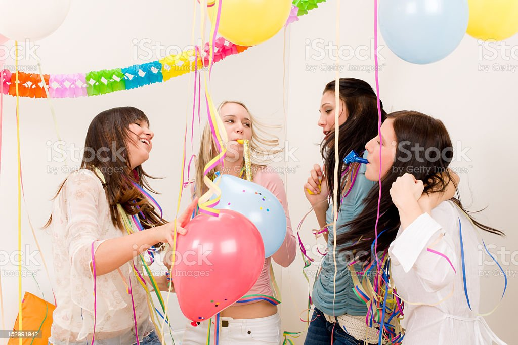 Birthday party celebration - four woman with confetti have fun royalty-free stock photo