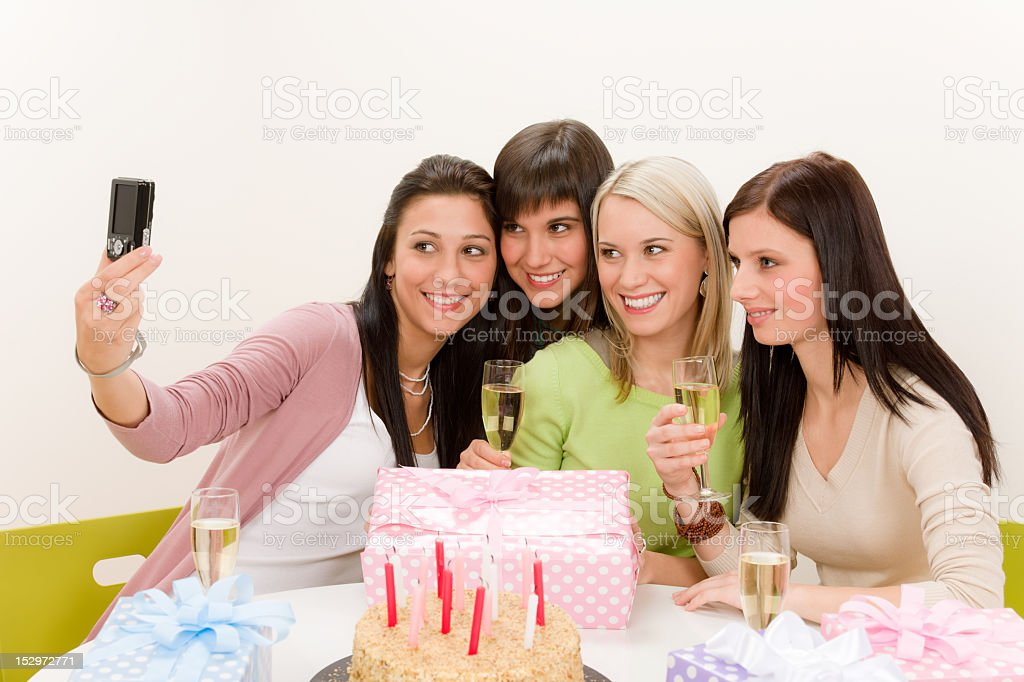 Birthday party - cheerful woman take photo with camera royalty-free stock photo