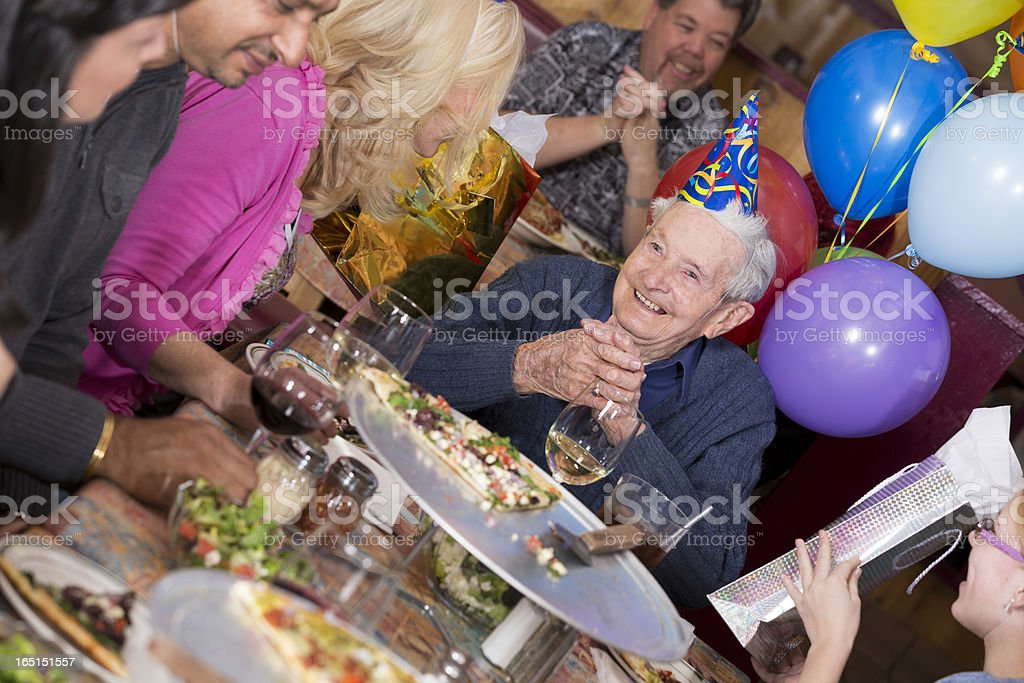 Birthday party of 90-year old man at a pizza restaurant royalty-free stock photo