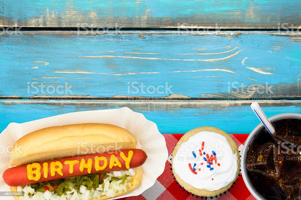Birthday Party Picnic with Cupcakes and Hotdog stock photo