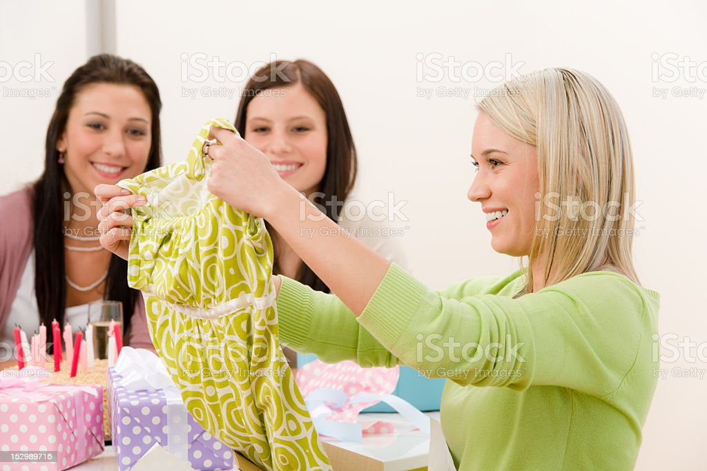 Birthday party - woman unwrap present, surprise royalty-free stock photo