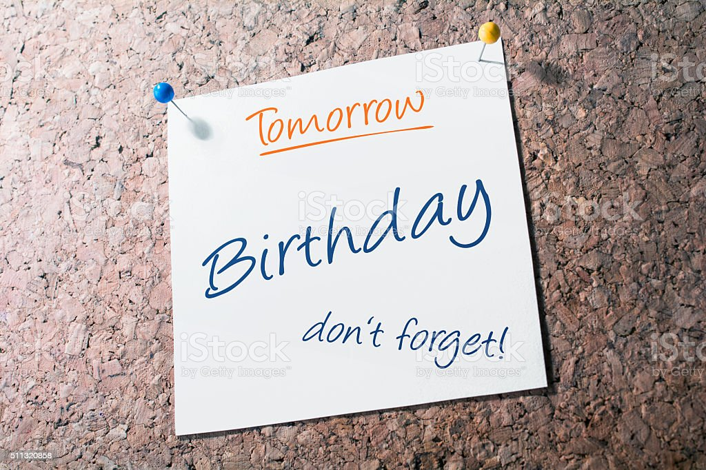 Birthday Reminder For Tomorrow On Paper Pinned On Cork Board stock photo